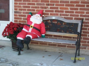 Waiting for Mrs Santa to join him with -- hot chocolate? coffee? hot buttered rum??????